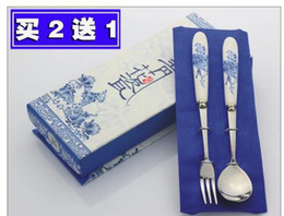 Wholesale Blue and white porcelain dinnerware set stainless steel chopsticks spoon small fork twinset gift