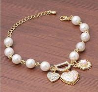 al por mayor pulsera del corazón de cuentas-Las pulseras de las mujeres de la manera rebordearon la joyería de los brazaletes de la pulsera de cadena de la aleación del corazón de la flor del diamante D de la perla de los filamentos