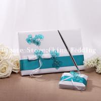 Wholesale Elegant White Ribbon Blue Flower Wedding Party Supplies Colour Schemes Accessories Guestbook and Pen Set