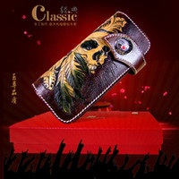 Wholesale Hong Kong OLG YAT New design Retro National style handmade carving leather wallet long hand bag leather carving Skull snakeskin wallet