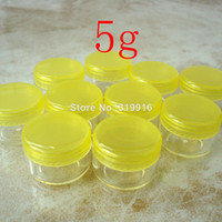 Wholesale pc g yellow round small sample plastic bottle jars containers with lids for cosmetic packaging cream jar