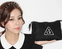 black Plastic Bag 2014Hot sale Korean STYLENANDA 3CE high quality fashion simple black makeup cosmetic bag beauty porrable bag organizer cosmetic case B4 50p