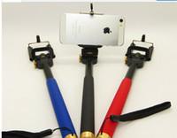 Wholesale Enhanced metal phones since the shaft Handheld autodyne artifact Camera stand alone Belt clip