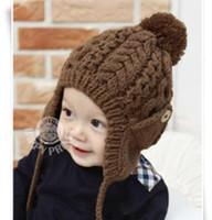 Wholesale Korean children s ear cuff button wool hat knitted hat double hanging ball warm winter beanie A122