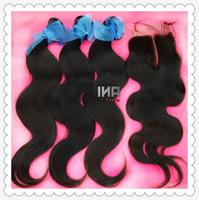 Cheap Brazilian virgin human hair extension 3 bundles hair and 1 silk base closure A