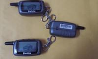 Fm two way car alarm Avis-Russie STARLINE A6 Démarreur à distance LCD à deux voies système d'alarme de voiture nouveau contrôle / émetteur FM à distance