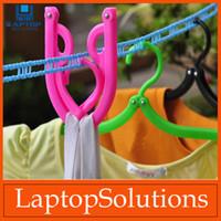 Wholesale 100pcs Traveling clothes hanger tourism foldable clothes hanger portable clothes hangers