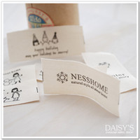 0202112 character ribbon - Chrysanthemum family nesshome black characters spring coltsfoot models woven label ribbon washed Mark cotton label