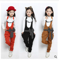 Girl Spring / Autumn Long 2014 Autumn New children outfit big girls white Bow tie shirt tops + polka dots bowknot Suspender Trouser 2pcs sets kids cotton sets A4527