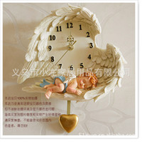 Wholesale European creative angel wall clock large bedroom wall clock silent cartoon character table when the clocks hanging garden living room