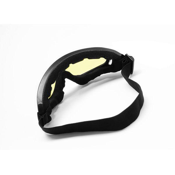 black snowboard goggles  riding snowboard