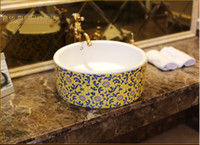 Wholesale Ceramic art basin on the stage of the basin that wash a face basin basin sink straight sweet and small yellow flowers