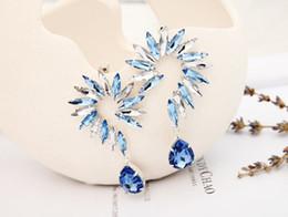 2014 joyería popular joyería de moda ojo pieza pendiente Flor de oro \ plata en forma de grandes pendientes de cristal para wmen desde piezas de joyería de moda fabricantes