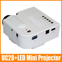 Wholesale 1 piece UC28 LED Mini Portable Home Theater Cinema Projector PC Laptop VGA USB SD AV input Black White
