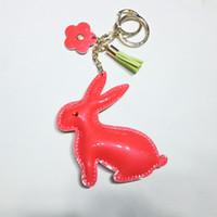 Wholesale Realistic Animals Gold Keyrings PU Leather Stuffing Sparkle Material Love Bow Knot Rabbit Sunflower Keychain Ladies Handbag Tassels Pendant