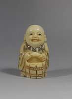 Wholesale Fine ox bone Carved boy hold water breaker figure Japanese netsuke