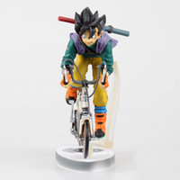 Wholesale Anime Dragon Ball Z Sun Gokou Riding Bicycle Desktop Real McCOY Series Action Figure Collectible Toy