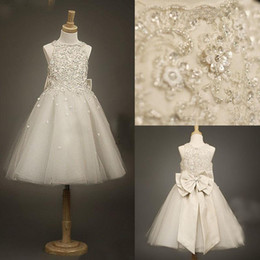 Wholesale Ivory flower girls dresses with Jewel Neck beaded Appliques Lace Crystal Glitz A line Girl s Pageant Bow knot Princess Gowns CPS024