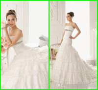 Wholesale Modern Ruched Strapless Crystal Belt Wedding gowns Appliques Lace Pearls Short Jacket Bridal gowns Tiers Court Trian Wedding dresses