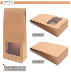 Wholesale Low price brown kraft paper bag with window X CM paper food packaging bag with stand bottom