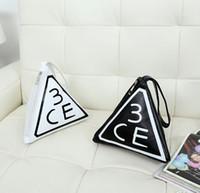 Cheap Hot-selling Korea Stylenanda 3CE Three Eyes Bags Large-capacity Portable Triangular Bag Cosmetic Handbags Free Shipping