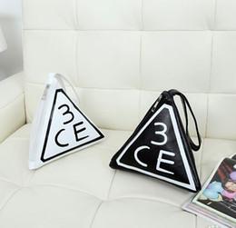 Wholesale Hot selling Korea Stylenanda CE Three Eyes Bags Large capacity Portable Triangular Bag Cosmetic Handbags