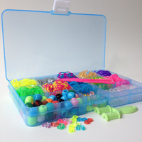Wholesale NEW Rainbow Loom Bands Kit pc Bands Colors with Loom color beads UV beads Clips charms pc Each cell Plastic case Best price
