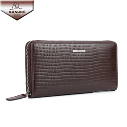 Wholesale 2014 Fashion Men s Wallet Genuine Leather Purse Male Long Zipper Wallet Day Cluth Card Holder Brand Wallet Embossed Wave Design Money Clip