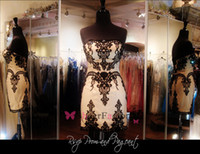 Reference Images Lace Strapless Cheap strapless homecoming cocktail dresses black lace appliques sleeveless backless sheath Mini short sexy formal party gown hot selling