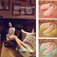 Wholesale 6 Design HOTSelling emitting luminous casual shoes men women LED lights USB charging shoe fashion sneakers Frozen A557 pair