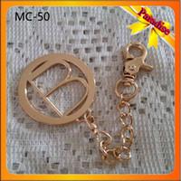 Wholesale MC Factory custom bag metal tag with leather metal plate key chain logo for lady handbag tag pendants for keychain fashion bag