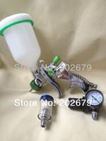 Cheap 601 high quality spray gun kit gravity stainless steel 600ml cup lvlp spray gun mini regulator air filter