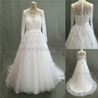Wholesale In Stock A Line Lace White Wedding Dresses with Bling Crystal Applique Jewel Back Covered Button Poet Long Sleeves Sweep Train Tulle Gowns