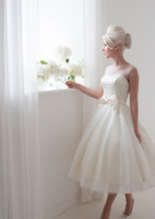ball spots - House of Mooshki Wedding Dresses Spot tulle tea length bridal gown with short cap sleeves and satin bow and pearl buttons