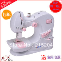 Cheap Free shipping Fashion Mini Handheld Portable Clothes Fabrics Sewing Machine with Adapter for DIY Wholesale