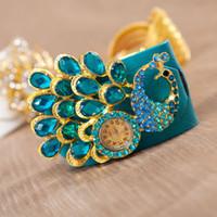 Wholesale 2013 the latest Bohemian style Fashion leather upholstery watch Peacock Rhinestones Belt bracelet watch