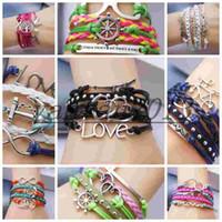 achat en gros de bracelet en cuir menotte-2014 nouveau Rivet love hearts ancre directionnel vétérinaire menottes bracelet multicouches en cuir tissé Bracelet charme mélangé