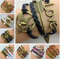 handcuffs - 10 style Infinity bracelet Hunger Games Sanga ancient bronze bow Love Harry Potter pearl wings handcuffs multilayer woven Bracelet