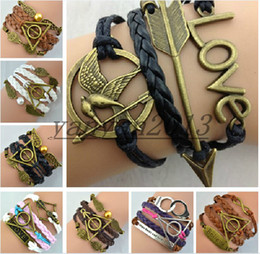 Wholesale 10 style Infinity bracelet Hunger Games Sanga ancient bronze bow Love Harry Potter pearl wings handcuffs multilayer woven Bracelet