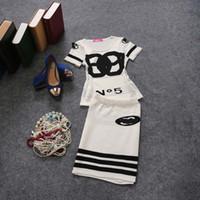 ladies white skirt - 2014 Double C Sets For Big Girls Autumn Elegant Cotton Knitting Sweater Stripes Skirts Lady Outfits Ladies Clothing Black White K1128