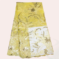 Wholesale Top grade yellow embroidery French net lace fabric with nice sequins CN27 organza lace cloth for dress