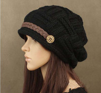 Wholesale woman knitting earmuffs hat fashion winter pure manual warm cap four color Christmas gift