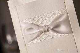 Wholesale 2015 Hot Latest Ivory Bow Embossed Flower Sole Elegant Free Personalized Wedding Invitations Cards