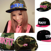 Wholesale The Korean version of men and women hip hop dance flat along the duck tongue camouflage TRUKFIT letters outdoor baseball hat