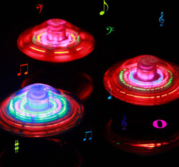 Wholesale 12pcs LED Flashing Light UFO Spinning SpinTop Beyblade Gangnam Style Music Laser rotating TOP Wind Up Kids Toy Christmas Party Decor