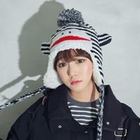 Cheap Korea purchasing power Zhilong winter warm mouth monkey cartoon cute plush ball ear hat knitting wool men and women