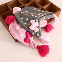 Wholesale 2014 new girls fashion knitting hats cute baby girl crochet Wool hat dots children winter warm ear muffs with bow top quality e090160