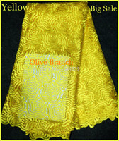 Wholesale African chemical water soluble Cotton Guipure Swiss Voile African rayol French Cord Lace Fabric clothing in yellow for sewing wedding dress