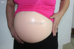 Wholesale different sizes of single pregnant artificial belly silicone tummy for fake pregnancy and actors famous nude color