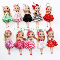 action wear - 10Pcs Mini Cute Puppet Keychain Action Figure Fashion Doll Key Chain Toys Wear Skirt Small Creative Gift